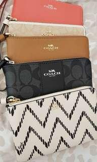 Coach Wristlet - left white / red / beige colors only