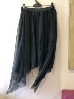 Asymmetrical skirt with inner pants