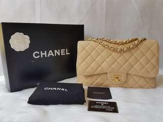 Discontinued Authentic Chanel jumbo beige caviar classic ghw single flap bag