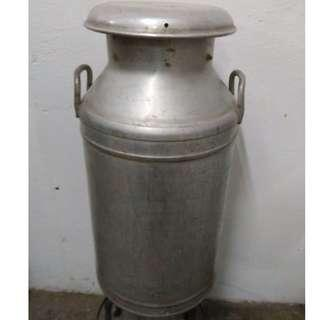 Antique milk can from 1957... (could be a bar stool?)