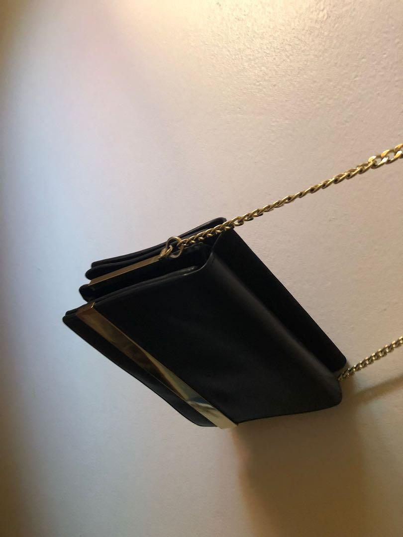 Charles and Keith double sided black and gold side bag