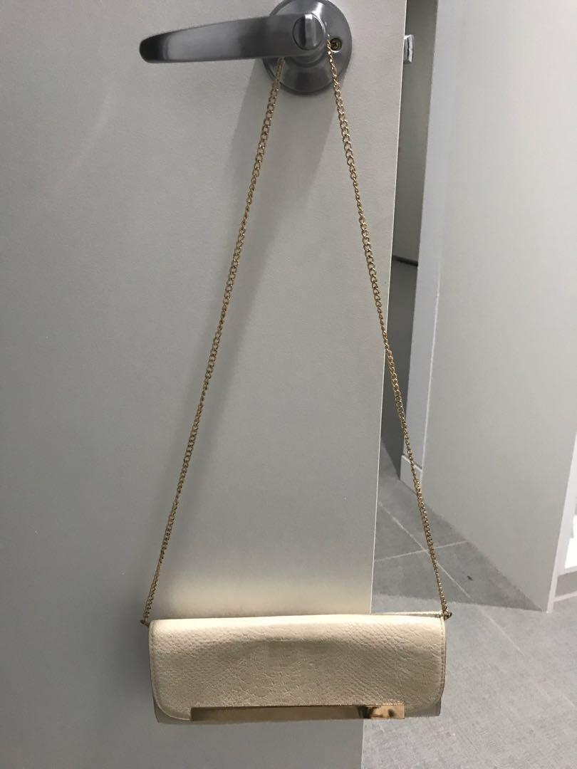 Colette hayman clutch handbag nude with gold chain brand new