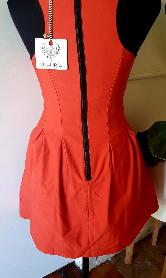 New orange dress, still with tags. Size 8.