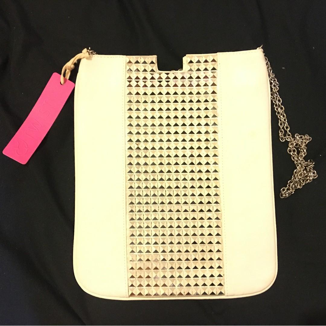 White cross body bag with silver details