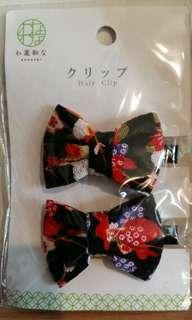 BRAND-NEW, UNOPENED FLORAL PRINT HAIR CLIPS