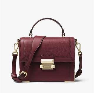 100% Authentic brand new Michael Kors small Jayne trunk crossbody bag