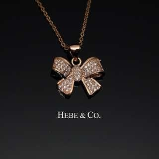 Hebe & Co. - 18k Rose Gold plated Crystal Ribbon pendant necklace (RRP: RM89.00)