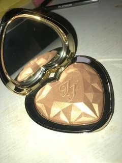 Too faced gold highlighter