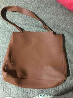 Brown synthetics leather bag