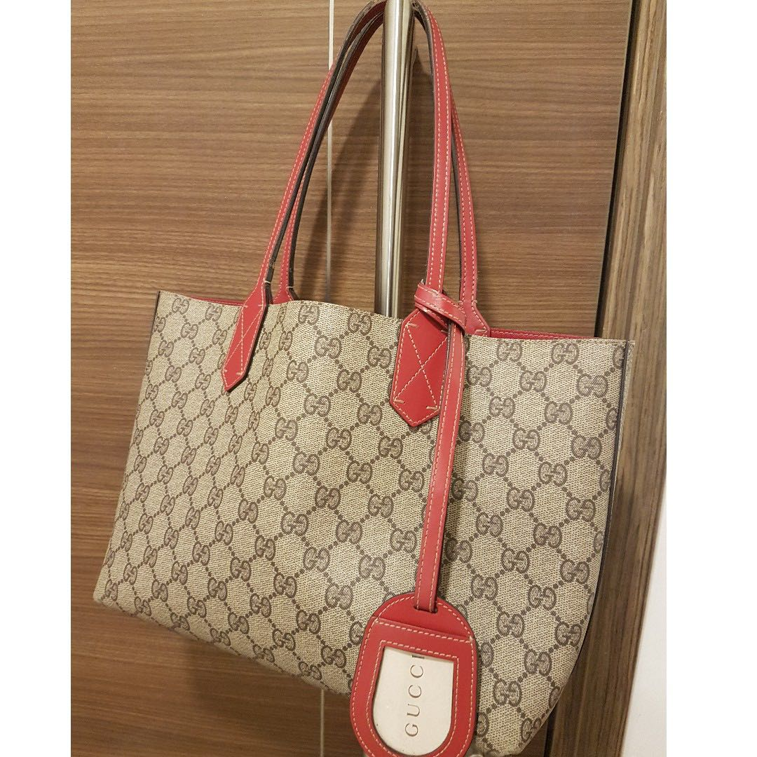07c9d97fe55a Pre owned Gucci leather reversible red tote bag - small size ...