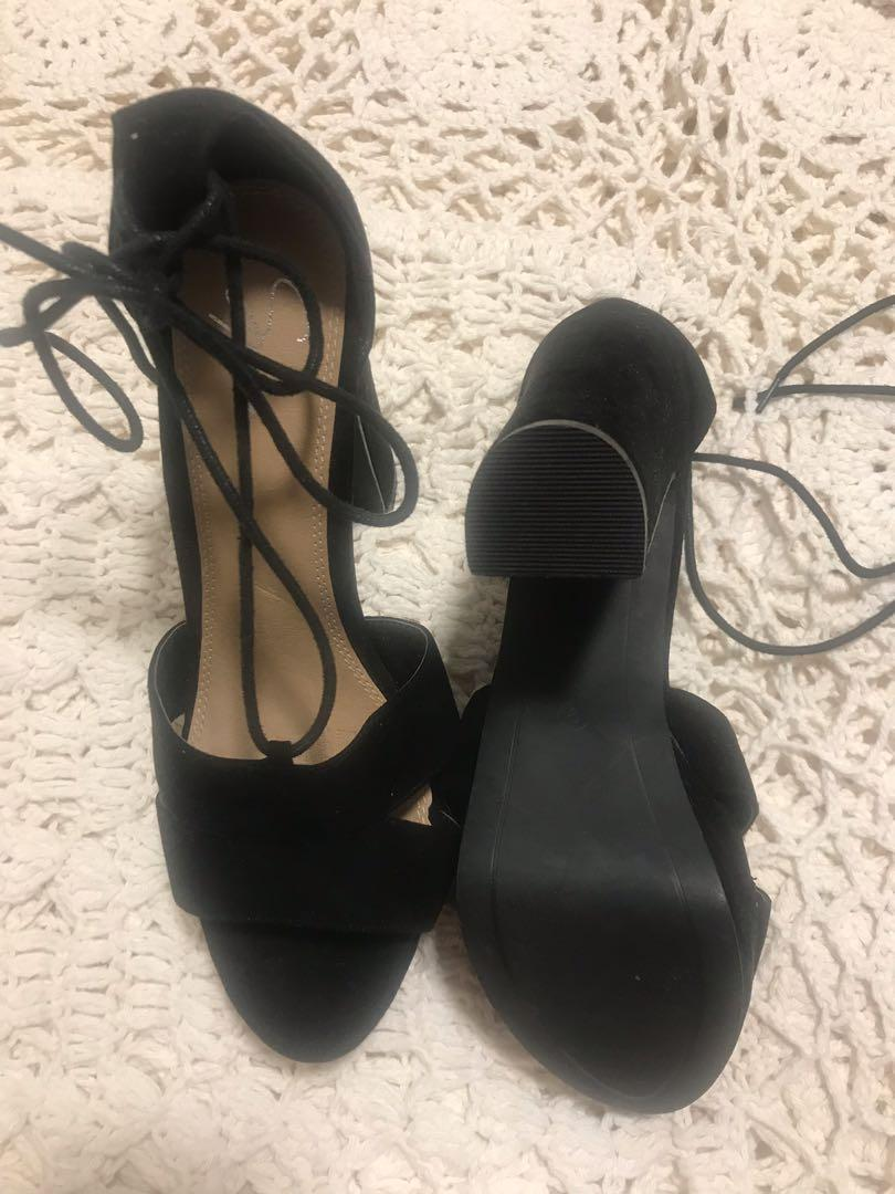 Spur high heel with lacing and suede like fabrication