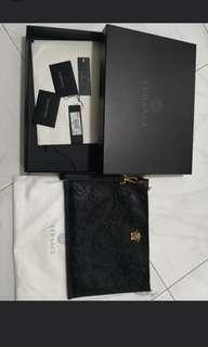 Super deal! Brand new versace leather clutch
