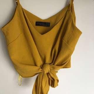 yellow tie up crop