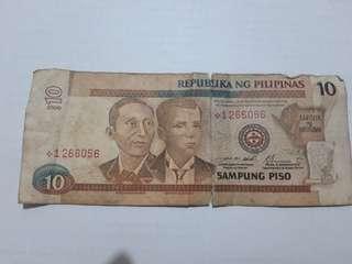 10 pesos star note bill red serial num