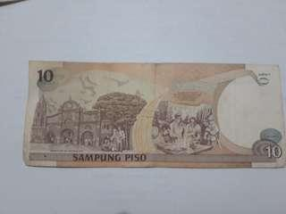 10 peso bill red serial num apolinario and andres