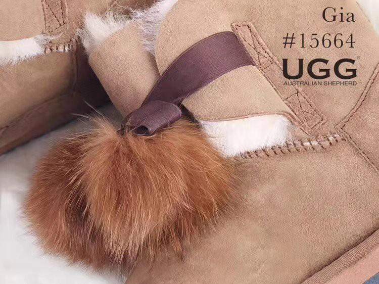 UGG Ladies Mini Boots with Ribbon Pom Pom Gia - Australian Double Face Sheepskin Water Resistant