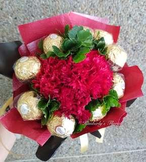 9 ferrero chocolate with 3 red carnations