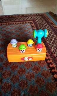 Toy with hammer