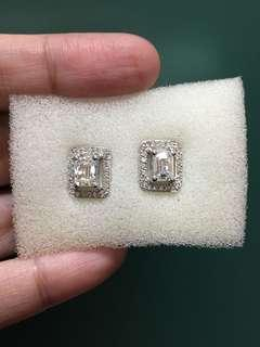 Emerald cut diamonds with enlarger