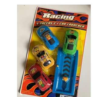 4 racer toy cars and 1 launcher