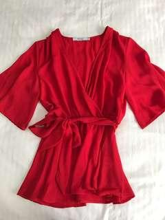 Red flowy top with belt