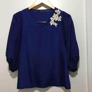 Blue Blouse with White Flower