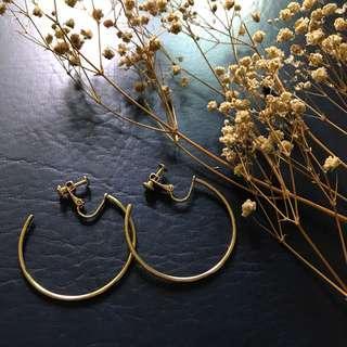 (Clip on) Gold hoop earrings