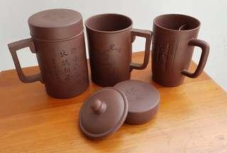 Ceramic tea cups and tea pot