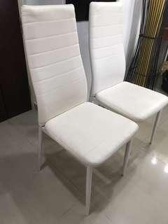 Twin white chairs