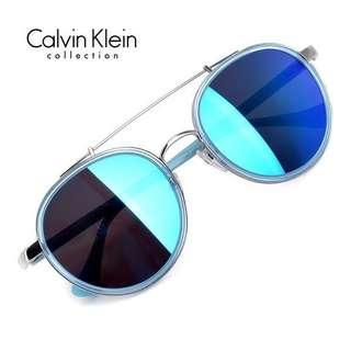 3580cac6e82 Calvin Klein round double bridge sky blue Sunglasses