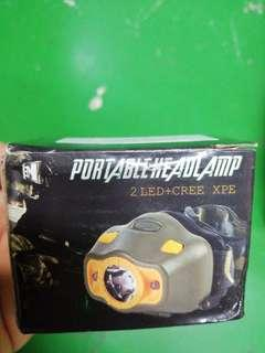 Portable headlamp comes with strap