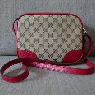 Authentic Gucci GG Monogram Canvas Bree Mini Messenger Bag Red