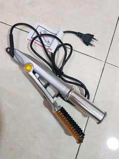 In styler  hair style comb