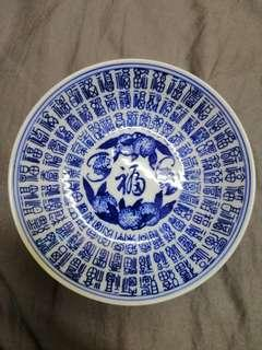 A pair of vintage blue & white lucky words plates.