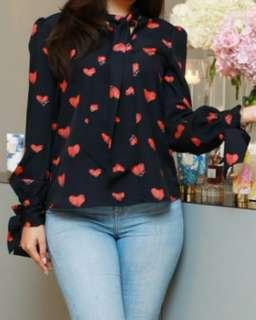 Looking for this black-red casual top