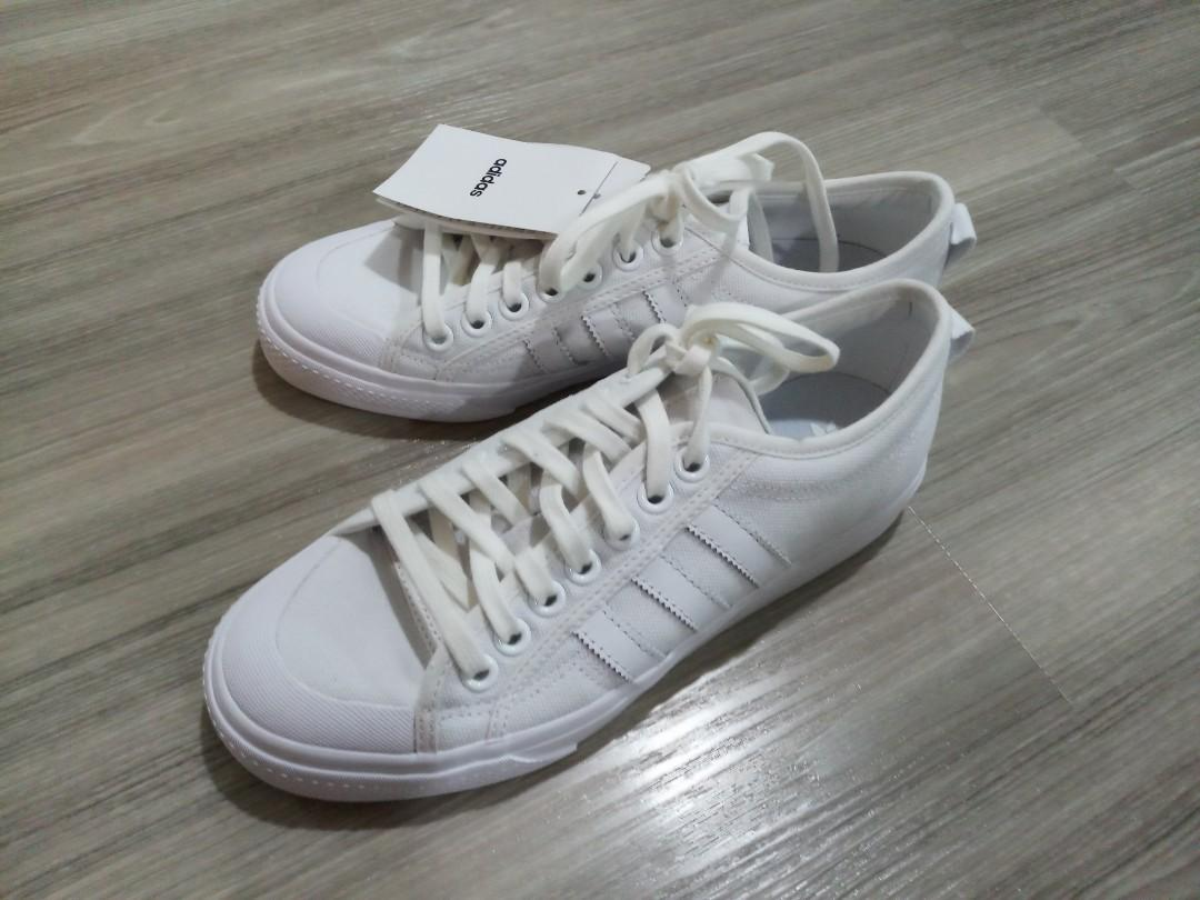 Brand new adidas white canvas sneakers