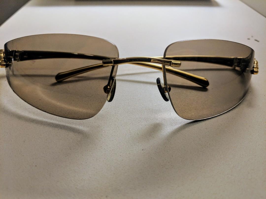 5c6a822eca0 CARTIER DESIGNER SUNGLASSES. Panthere De Cartier Rimless Sunglasses ...