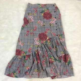 Long uneven ruffled floral skirt