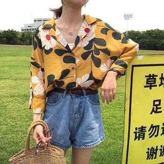 Floral yellow shirt
