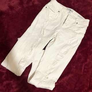 White skinny ripped pants