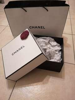 Authentic Chanel box and paper bag