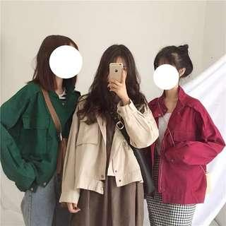 Apricot/green/red jacket