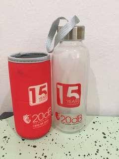 Glass bottle with sleeve holder