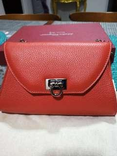 Salvadore Ferragamo deep orange clutch sling bag