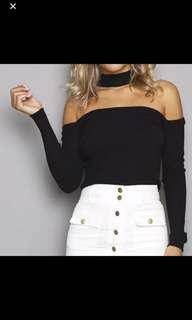 Black long sleeved knit top with neck band