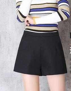 Black mid rise structured shorts