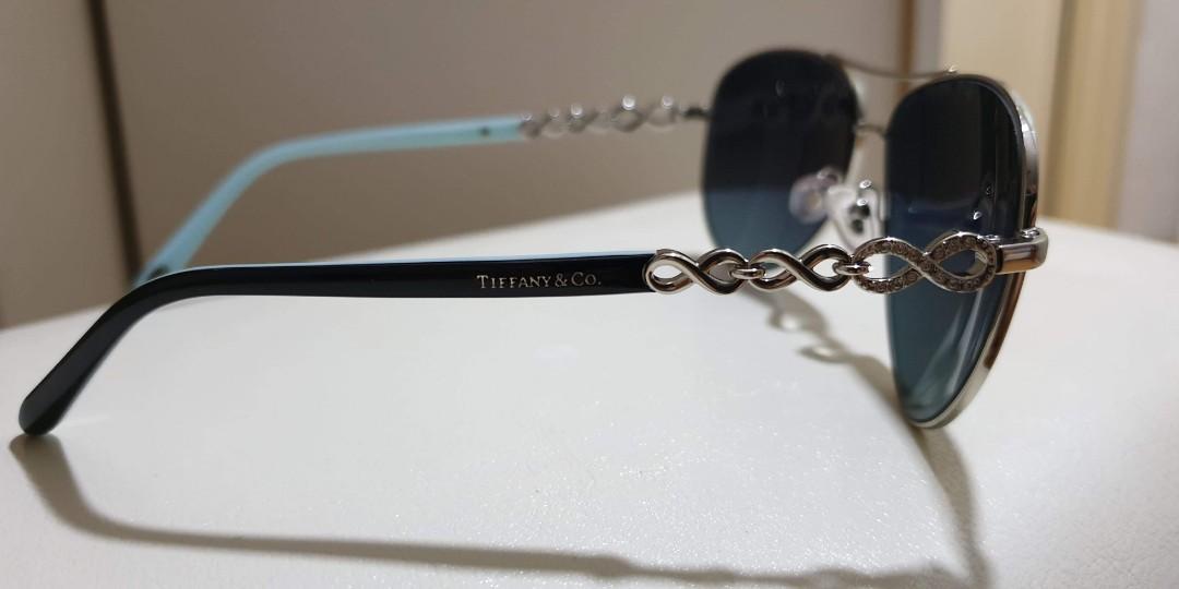 Brand New Sunglasses Brand: Tiffany & Co (Original) Lens Color: Silver Blue Type: Polaroid Lenses