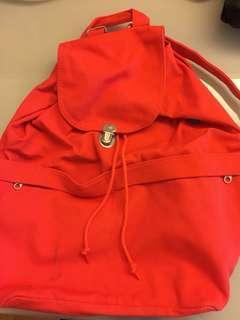 BAGGU reddish orange backpack