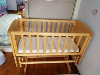 🚚 Mothercare Deluxe Gliding Crib - Wood colour