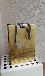 Burberry gold paper bag